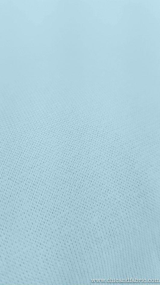 Tejido punto jersey azul cielo