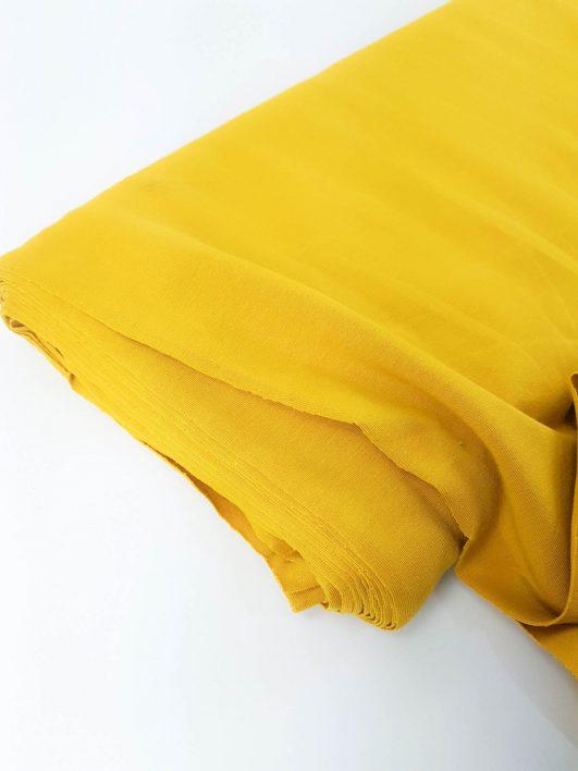 Tejido punto camiseta de algodón orgánico liso mostaza