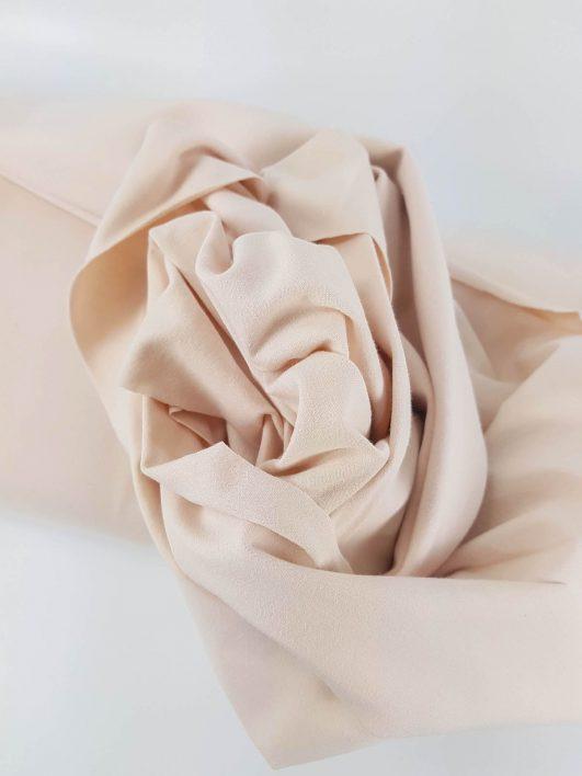 Tejido punto camiseta de algodón orgánico liso rosa maquillaje