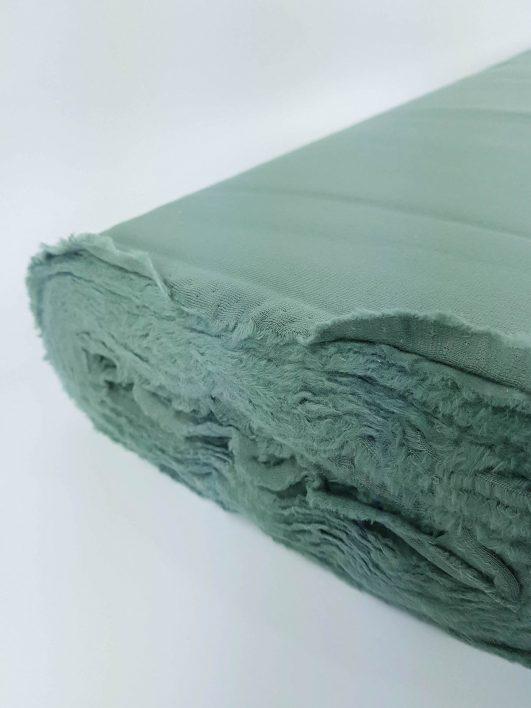 Tejido punto sudadera de algodón orgánico liso verde militar