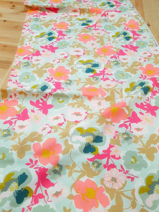 Popelín de algodón fino de flores en menta y colores flúor