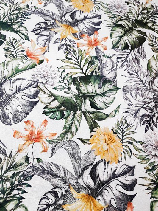 Tela de hojas tropicales con flores en amarillos y naranja en half panamá