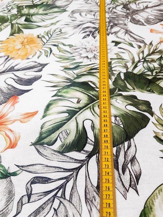 """Tela de hojas tropicales """"wild jungle""""con flores en amarillos y naranja en half panamá"""