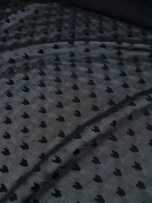 Gasa de color negro con plumeti