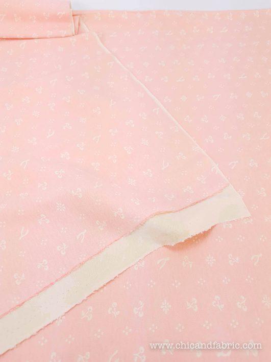 Jersey bio à pois blancs sur motif rose Birch Fabrics