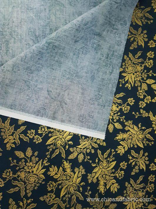 Tessuto con stampa floreale con filo dorato