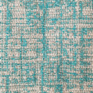 Jacquard para tapizar jaspeado en verde esmeralda y tono natural