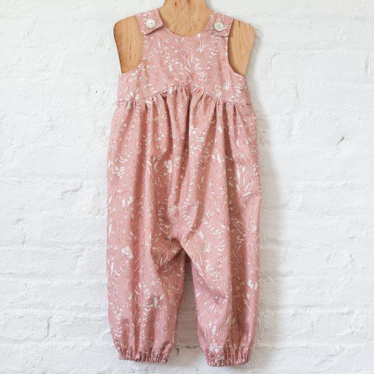 Vestido de niña en rosa con flores en algodón ecológico