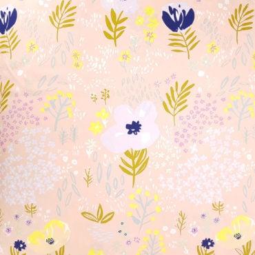 Tissu chaud saumon pastel avec des accents dorés
